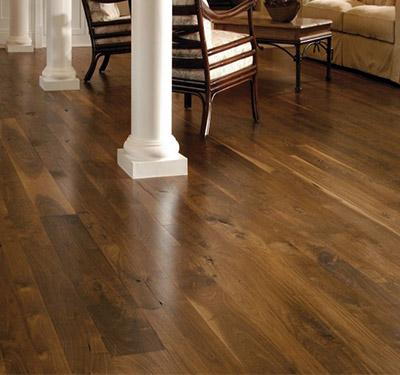 Spacious room with walnut plank floors